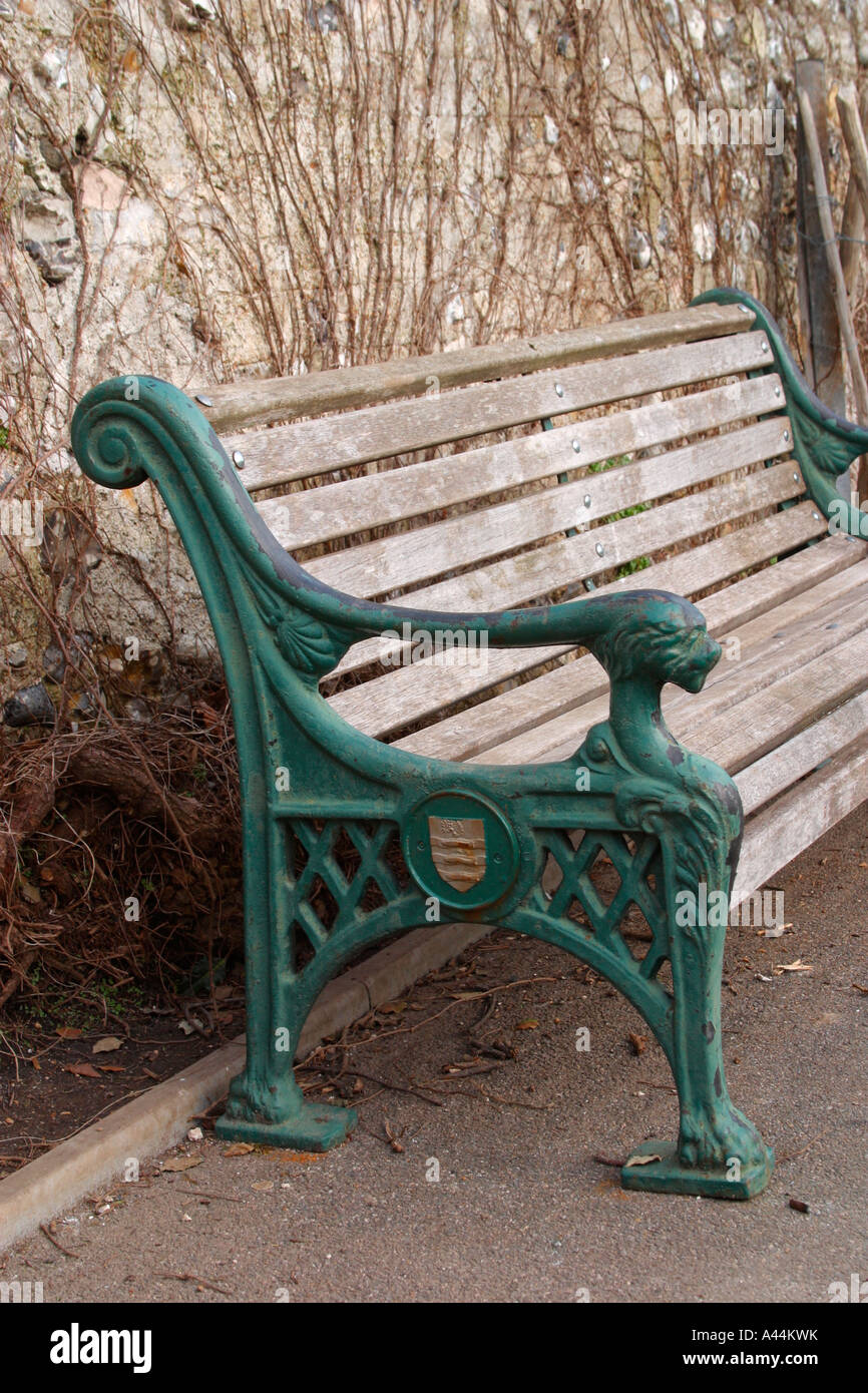 Wooden Park Bench With Green Painted Wrought Iron Armrests Stock
