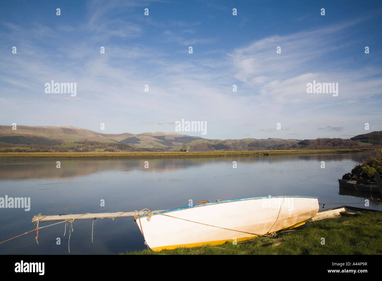 GLANDYFI CEREDIGION MID WALES UK January A white rowing boat is moored at the side of the very wide River Dovey - Stock Image
