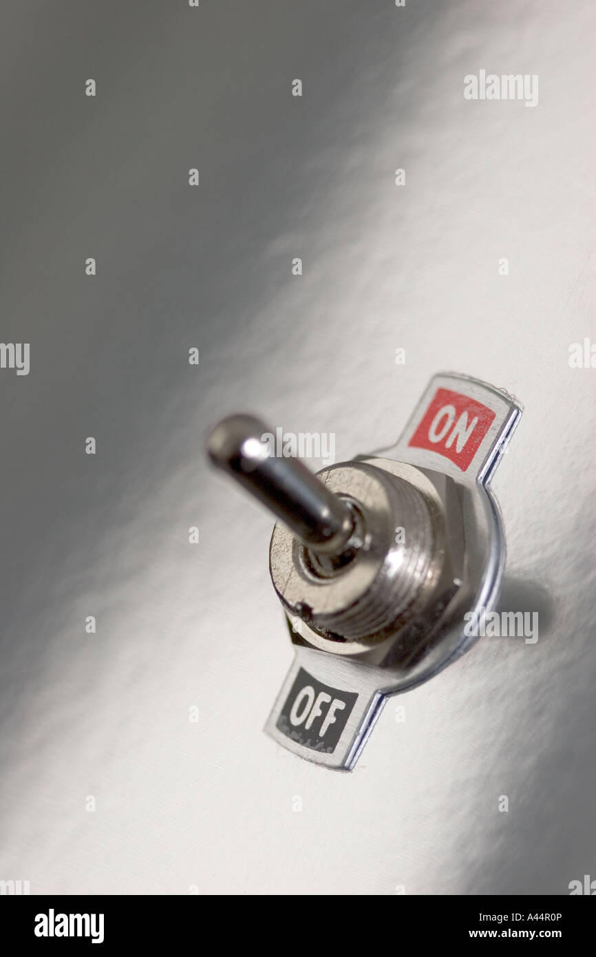 Abstract graphic image of an electric toggle switch on a shiny silver background - Stock Image