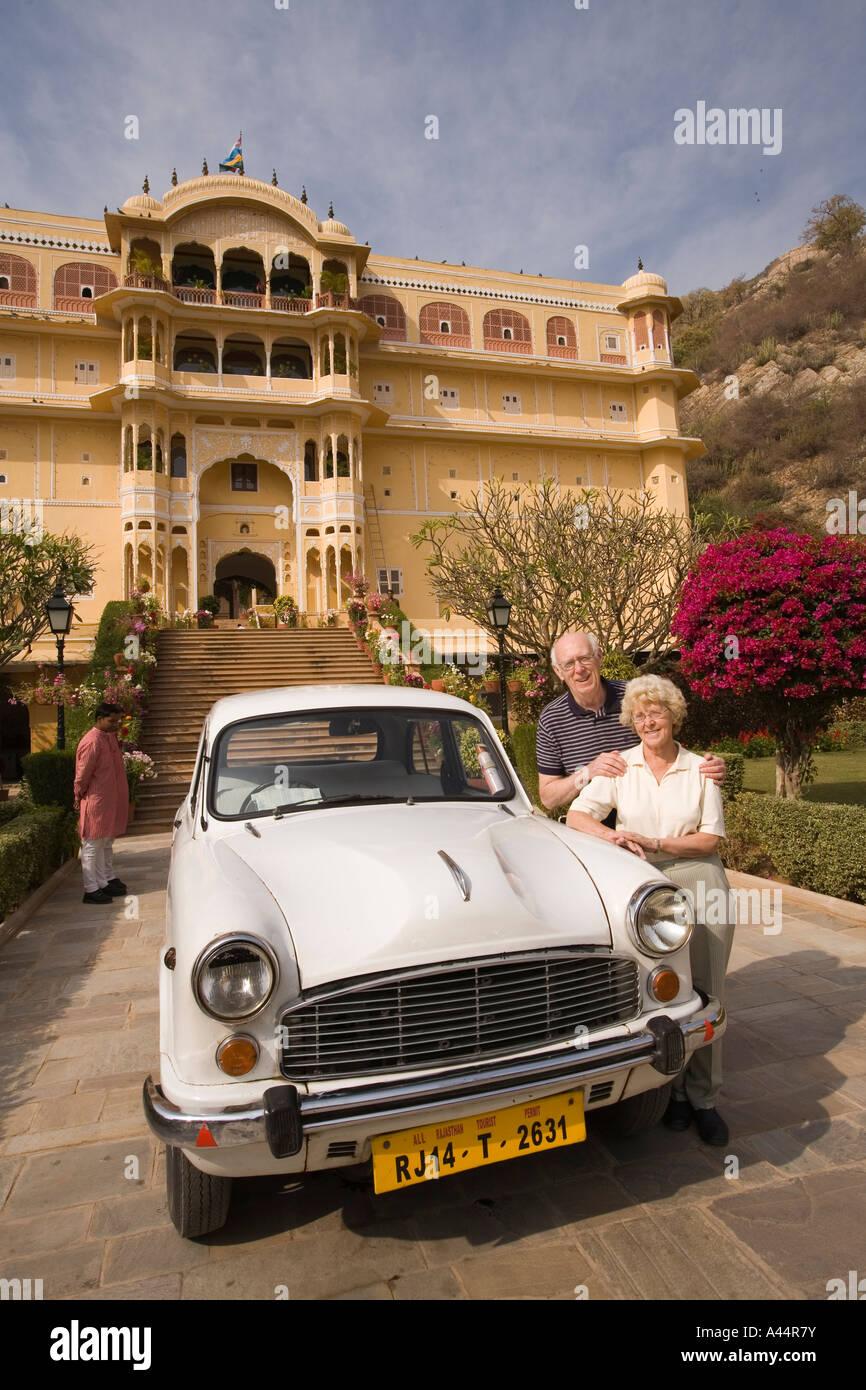 India Rajasthan Samode palace near Jaipur older western tourists with Hindustan Ambassador car - Stock Image