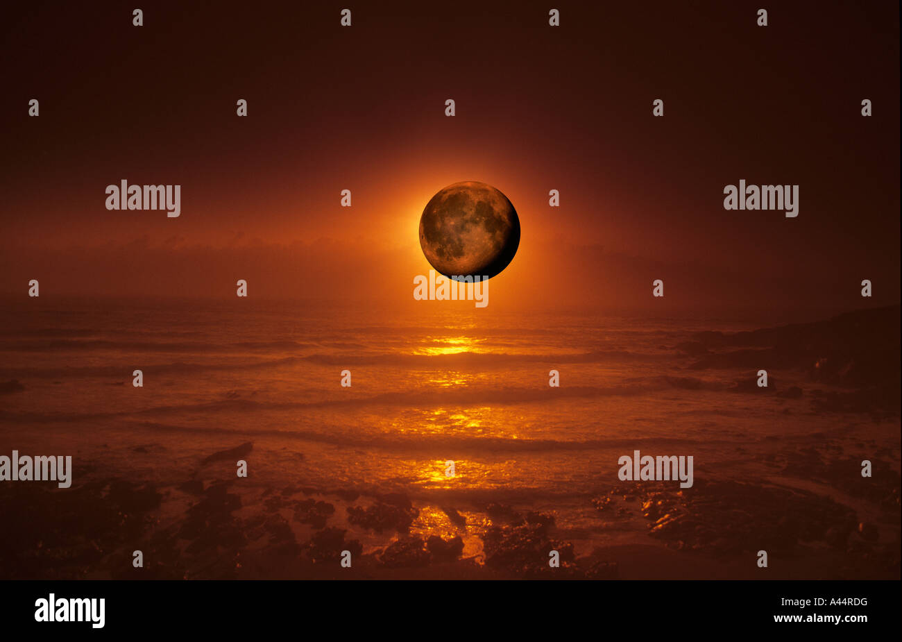 Sunset & Moonrise Over The Atlantic Ocean,Taken In Newquay Cornwall UK. Stock Photo