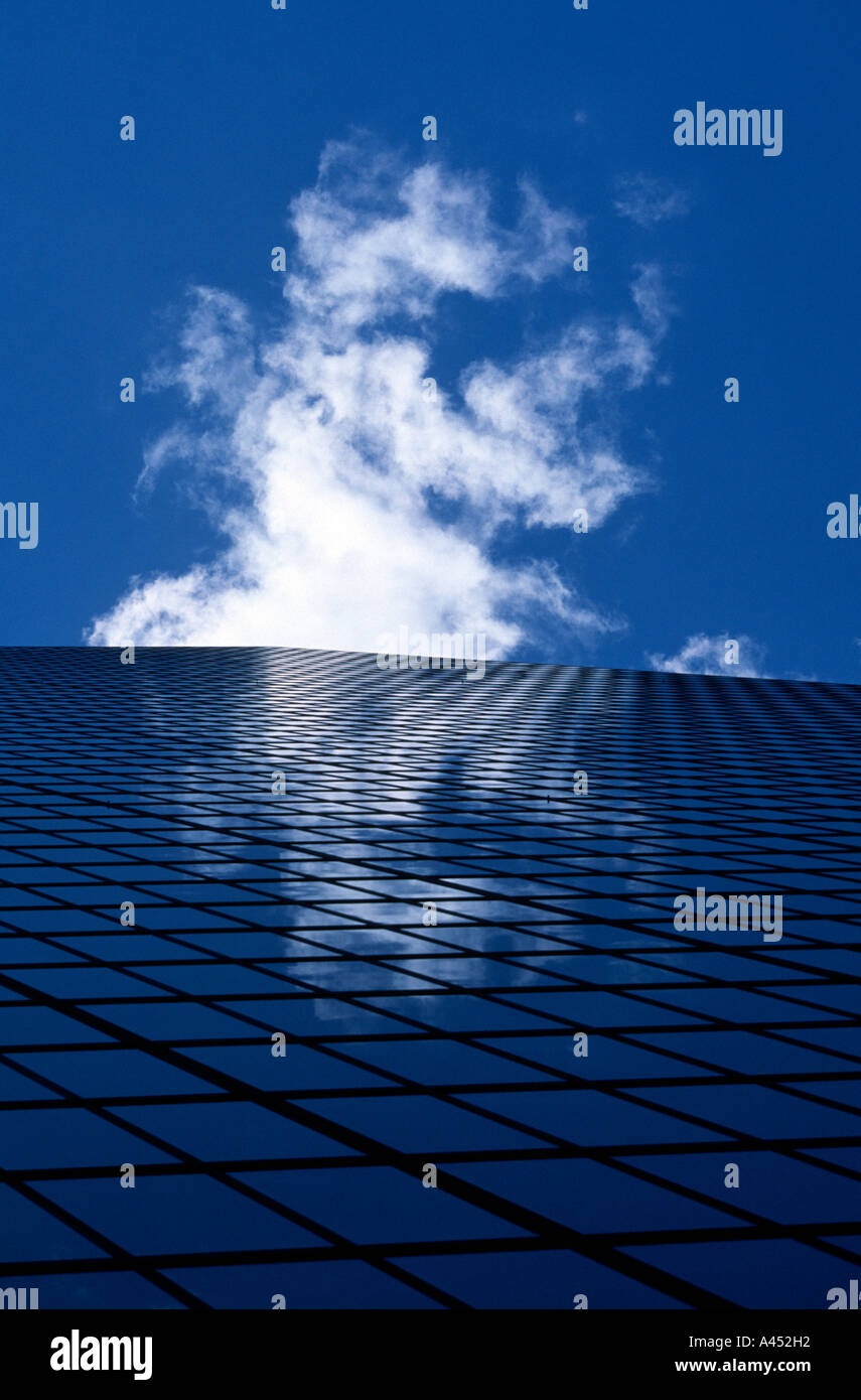 Looking up Hancock tower, a glass faced building to emerging cloud and it's reflection, Boston, MA - Stock Image