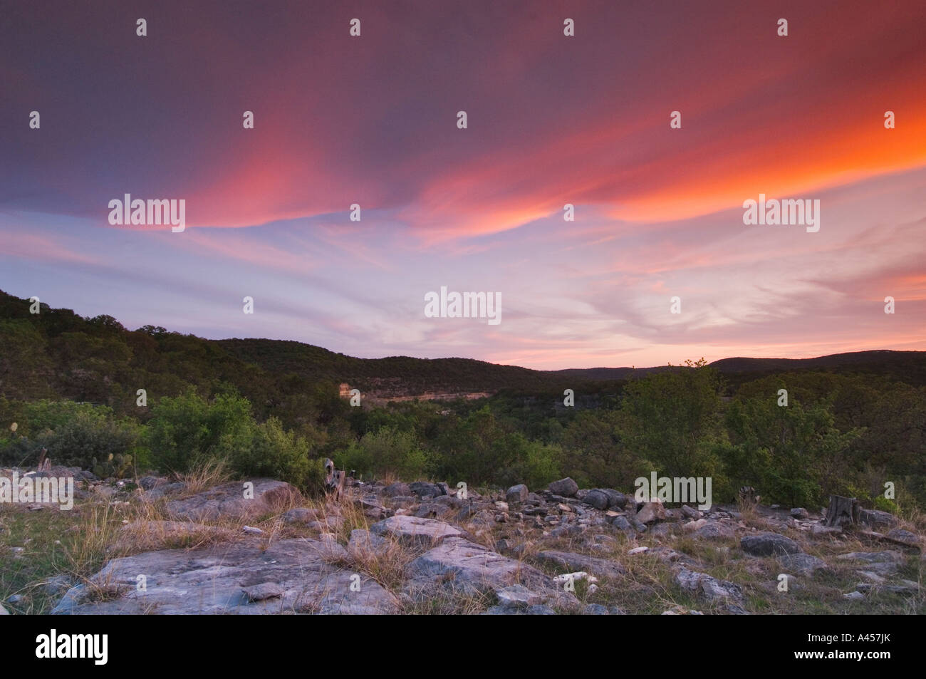 Susnet with colorful clouds over the Hill Country in Texas, USA Stock Photo