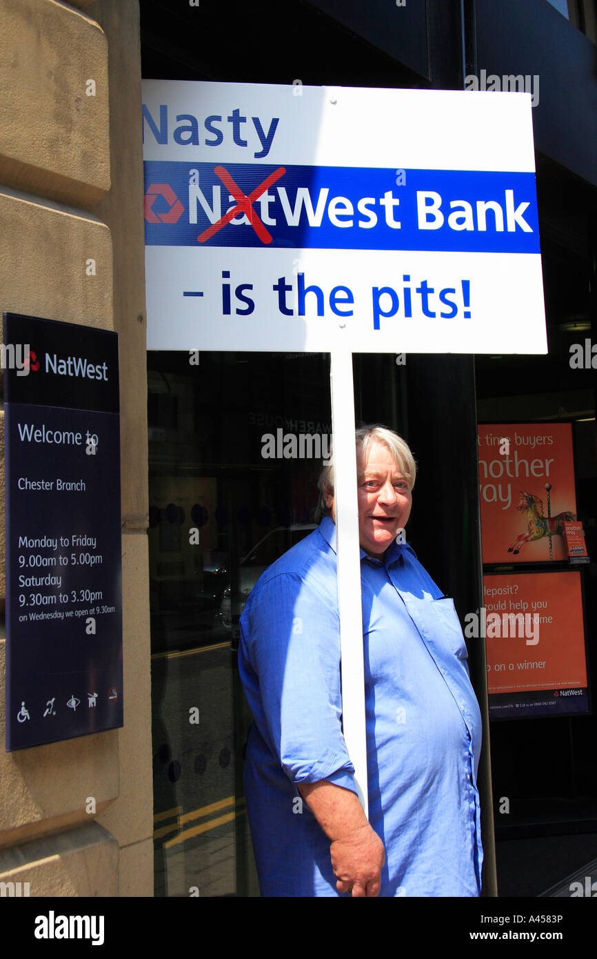 Protester outside Natwest bank Chester Protesting against excessive charges June 2006 - Stock Image