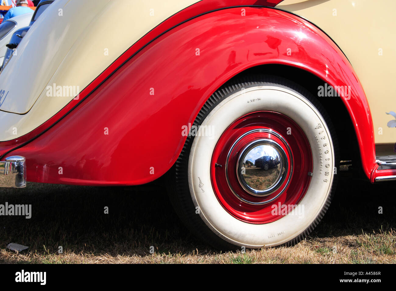 Firestone whitewall tyre wheel arch of vintage car - Stock Image