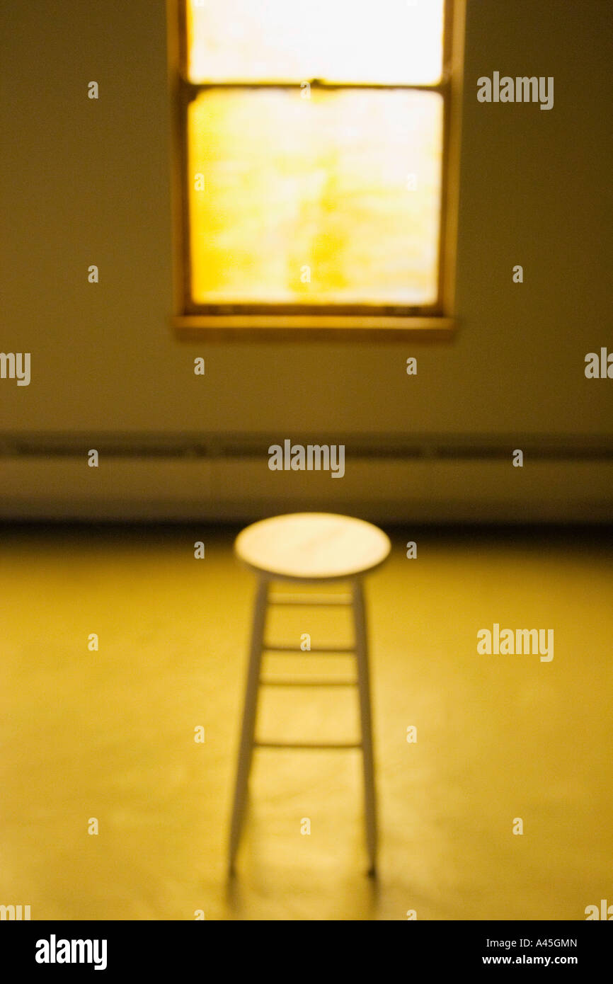 selective focus of alone quiet peaceful anxiety separation abandonment vacant empty deserted mysterious  warm yellow - Stock Image