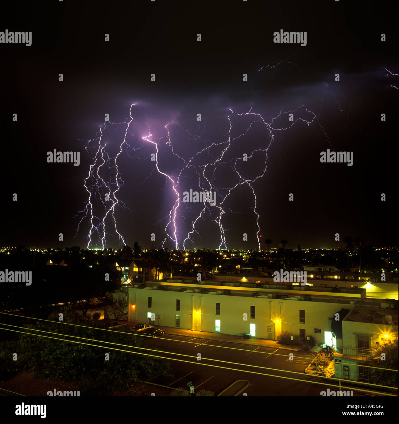 lightning striking over the city of tucson arizona usa during a