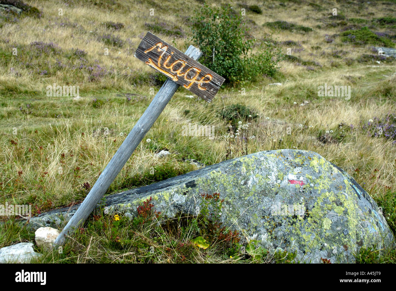 Lopsided hiking sign Miage at Mont Truc Haute-Savoie France - Stock Image