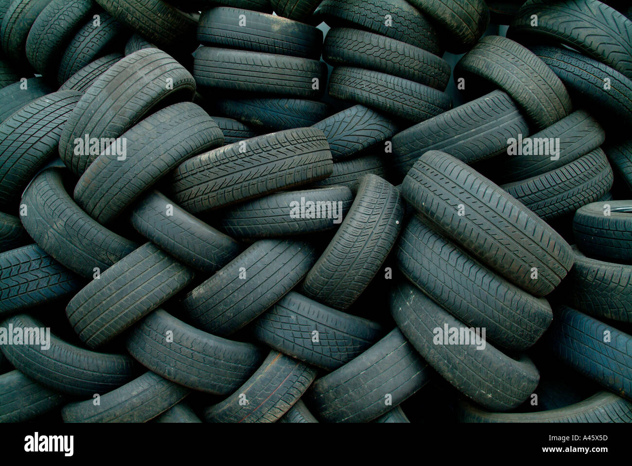 Pile of old car tyres - Stock Image