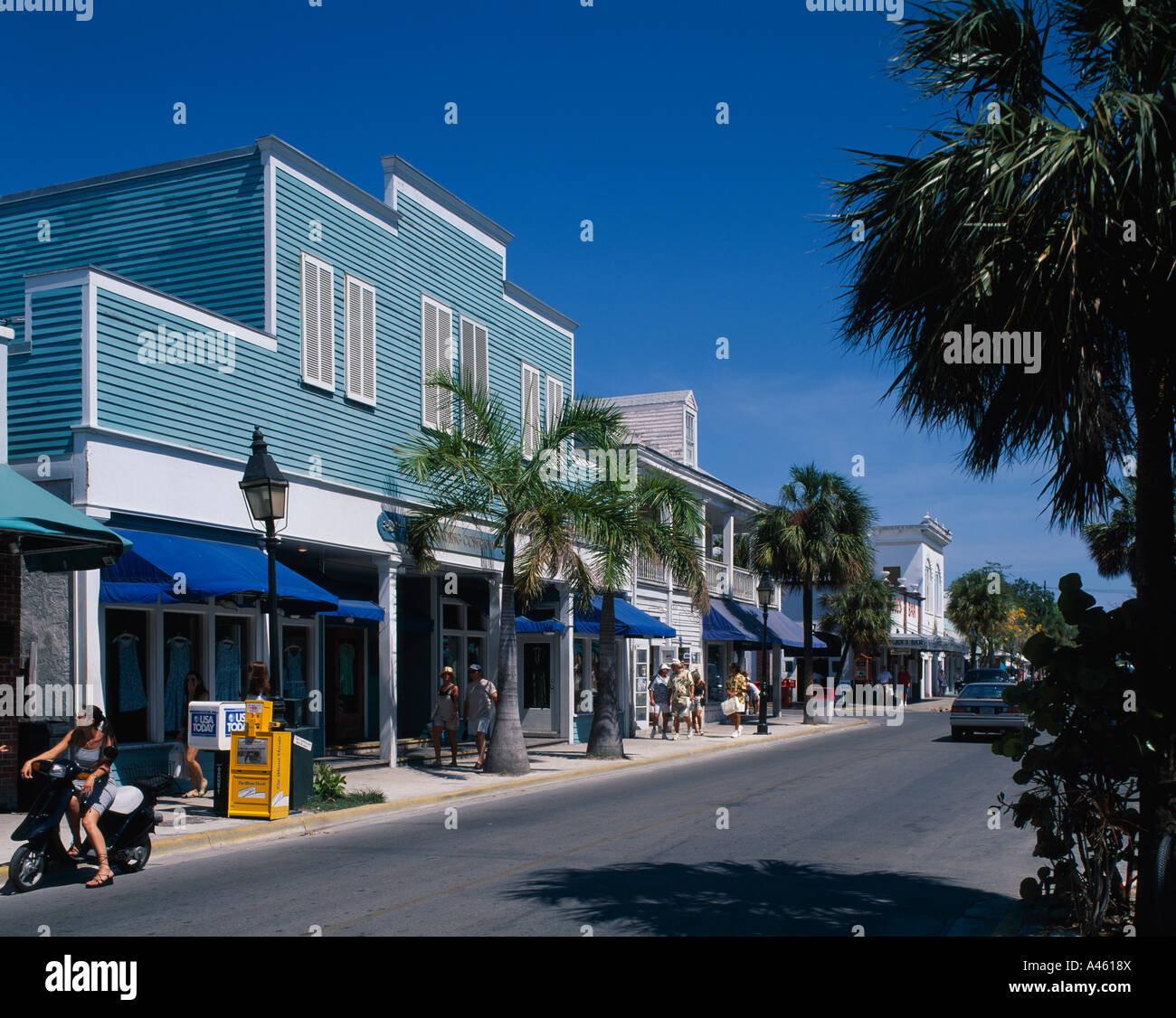 USA Florida Keys Key West Duval Street Palm Lined Road With Timber Frame  Pastel Colour Painted Shops
