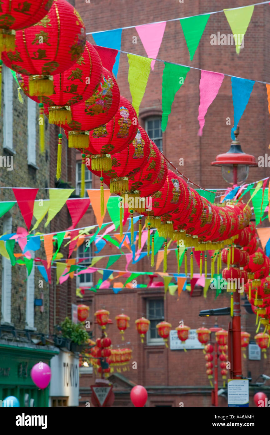 Row of red Chinese lanterns hanging above Newport Place, New Year parade, Chinatown, London, England, UK Stock Photo