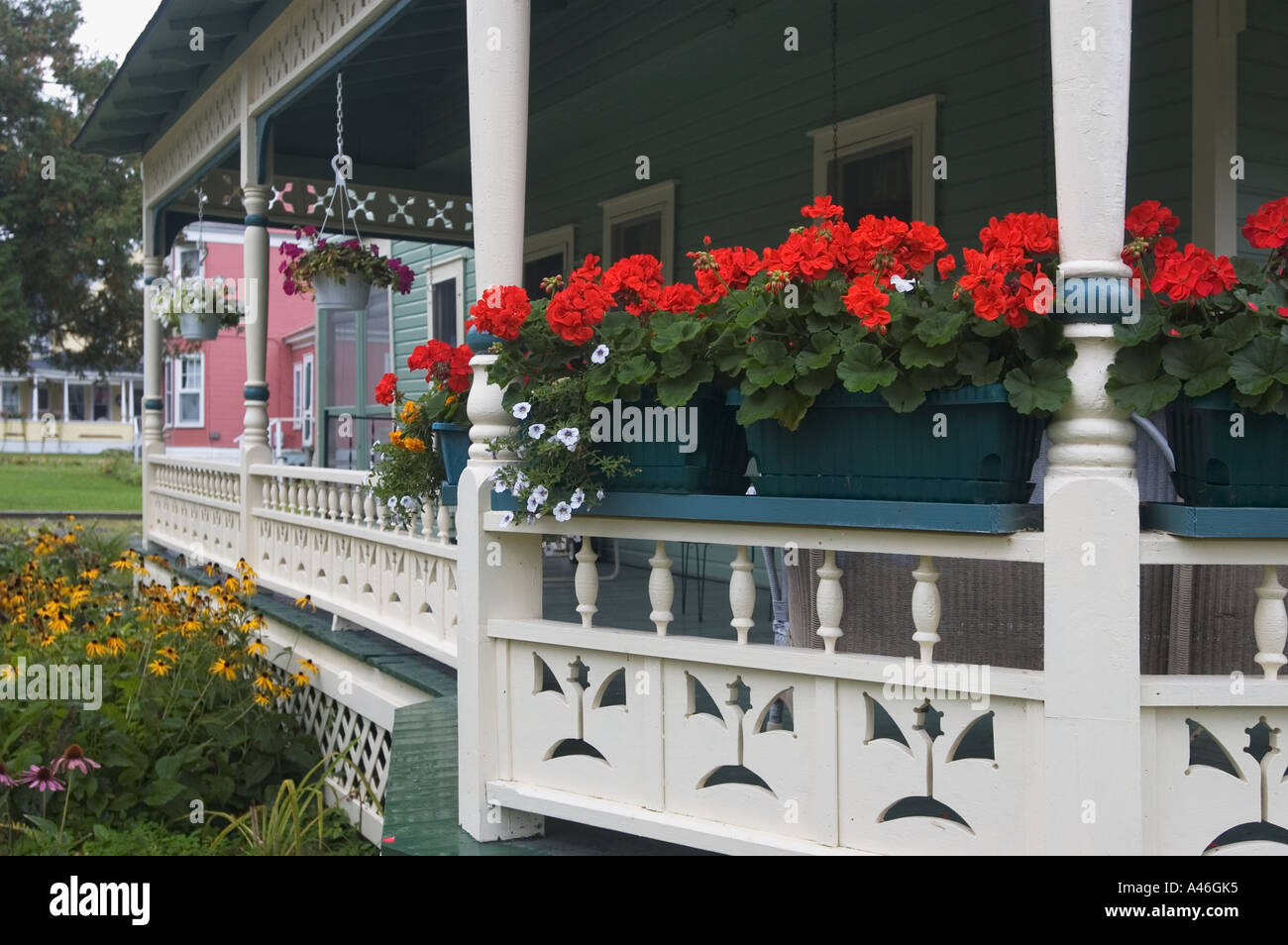 Geraniums Other Flowers On Porch Of Victorian Home Thousand Island Park New York Stock Photo
