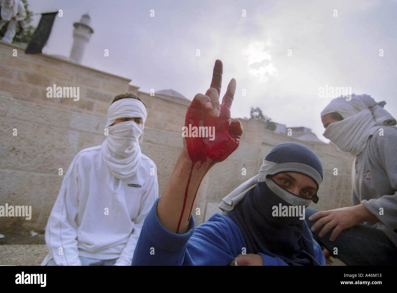 al aqsa mosque clash a palestinian demonstrator dips his hand in the blood of amar mehnies a 16 year old boy killed - Stock Image