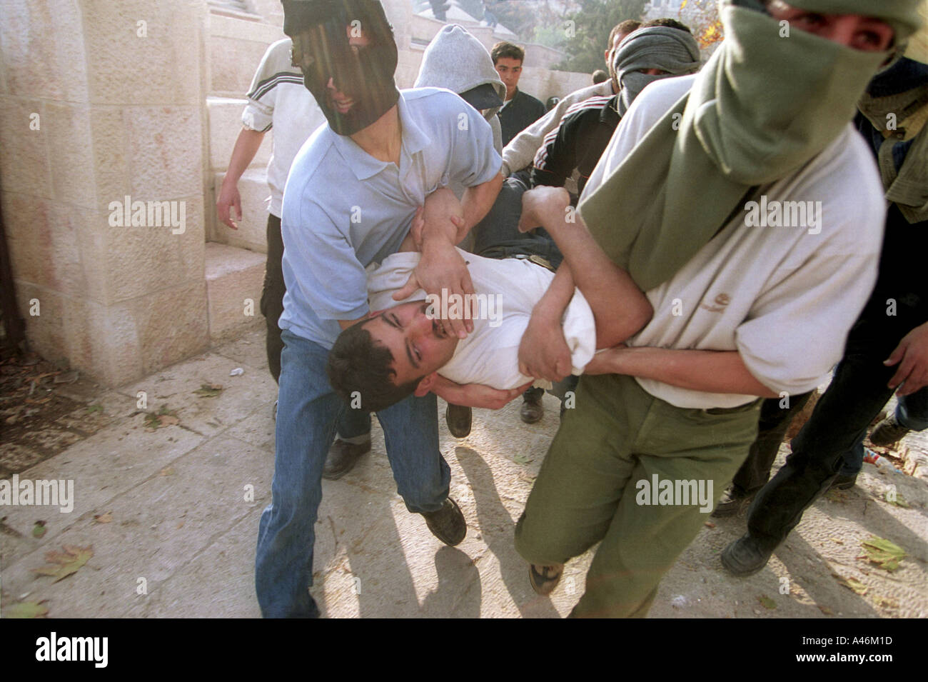 al aqsa mosque clash a palestinian demonstrator is carried to an ambulance after being shot during a clash with the israeli army on the 13th anniversary of the first intifada - Stock Image