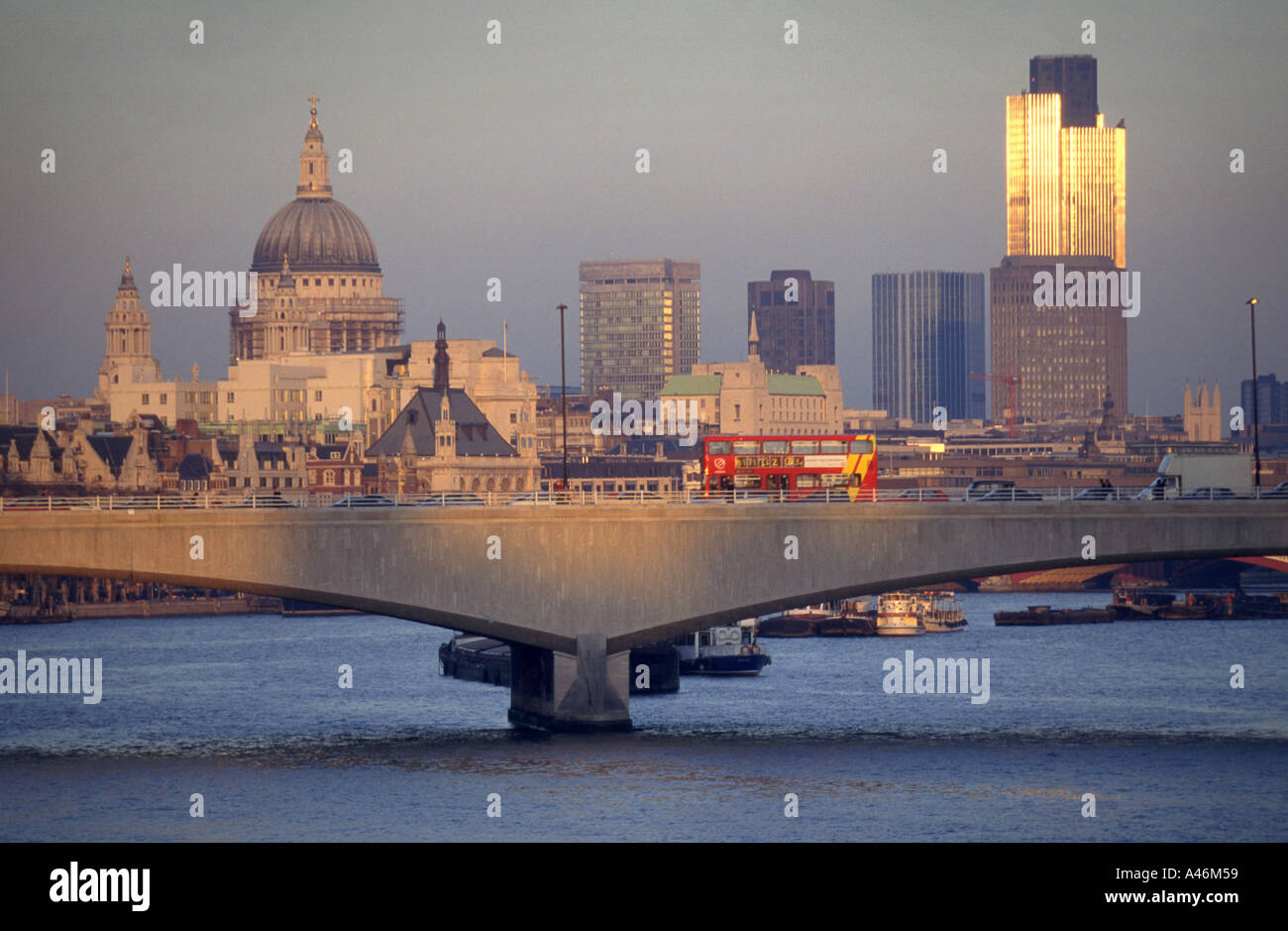 A view of Waterloo Bridge crossing the River Thames in London, showing St Pauls Cathedral and the Nat West Tower Stock Photo