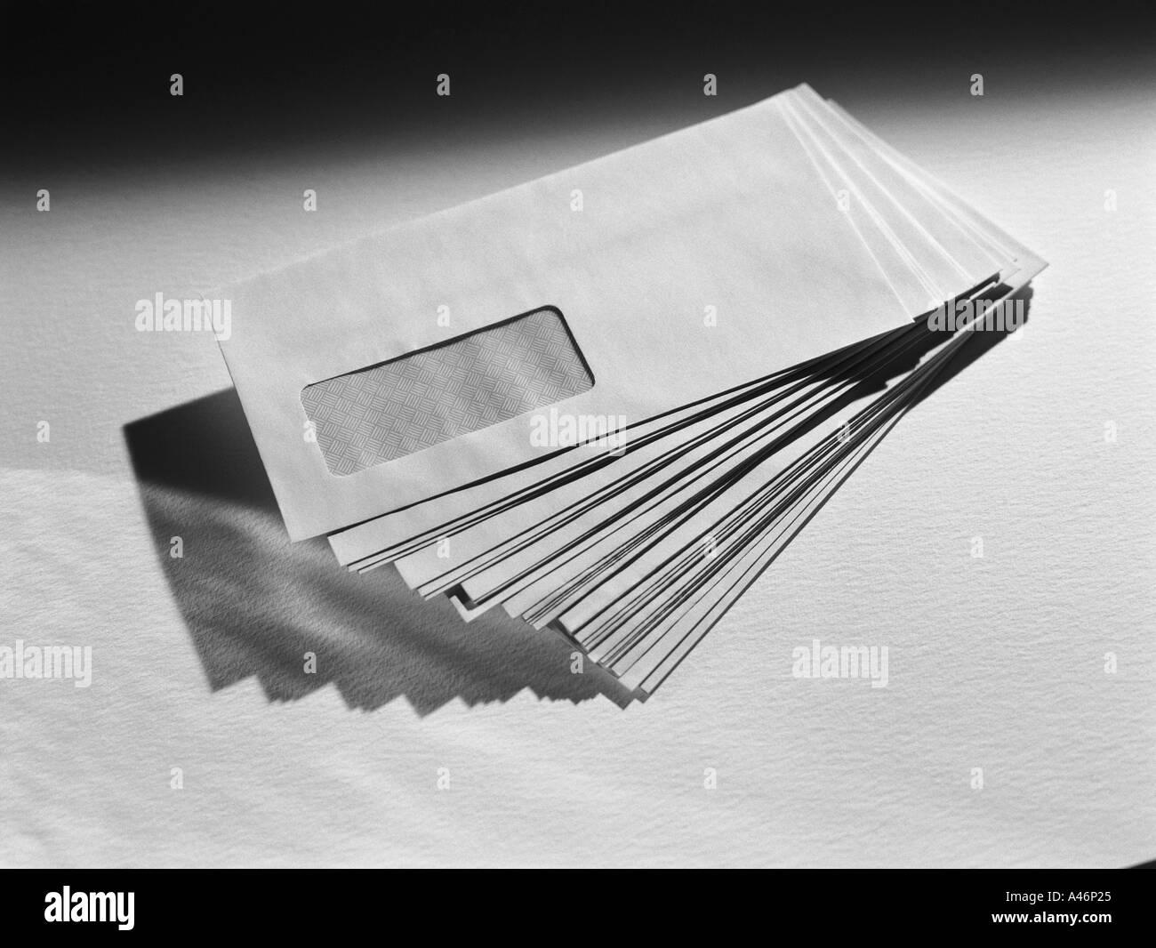 Stack of white envelopes - Stock Image