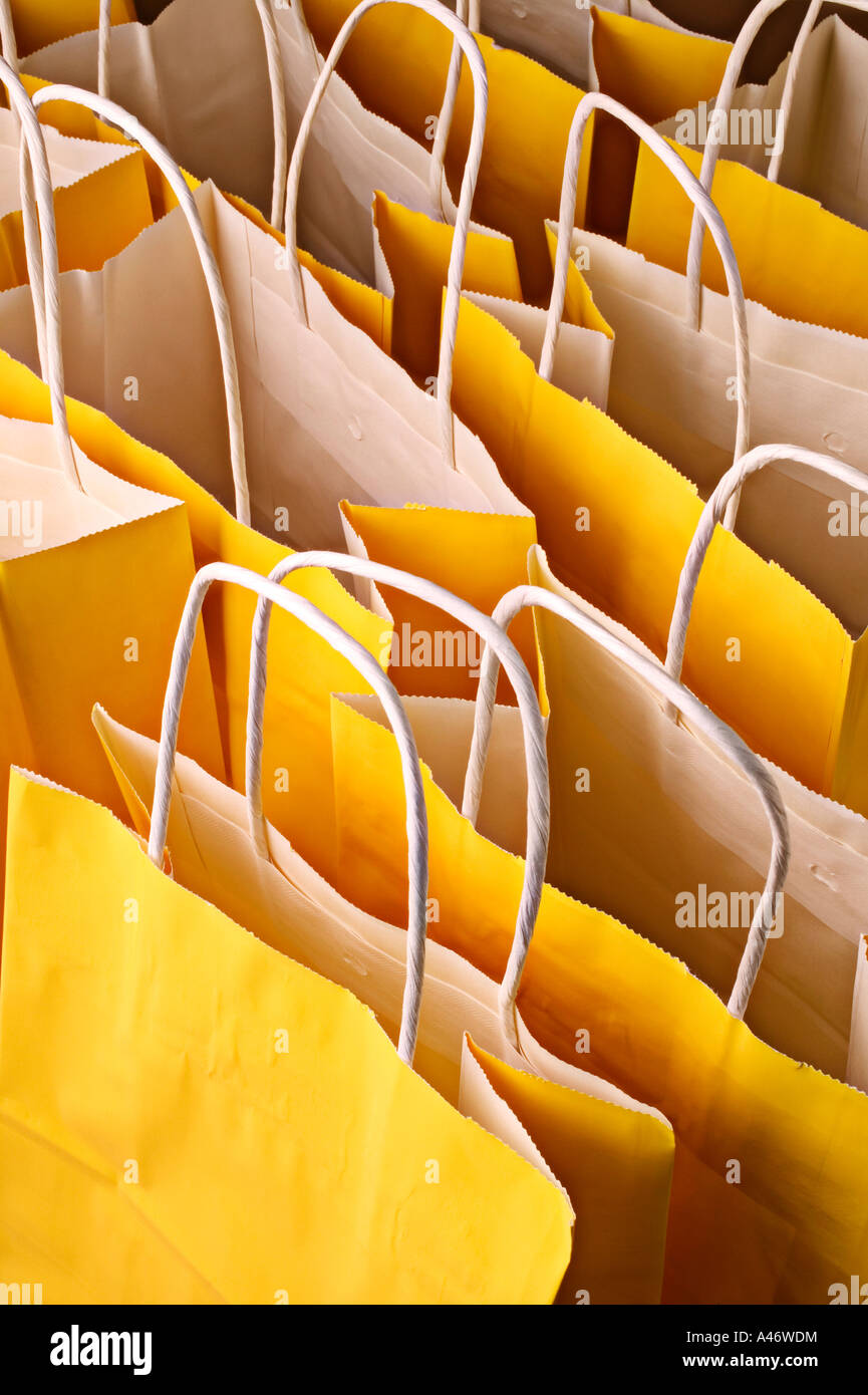 a group of yellow gift bags - Stock Image