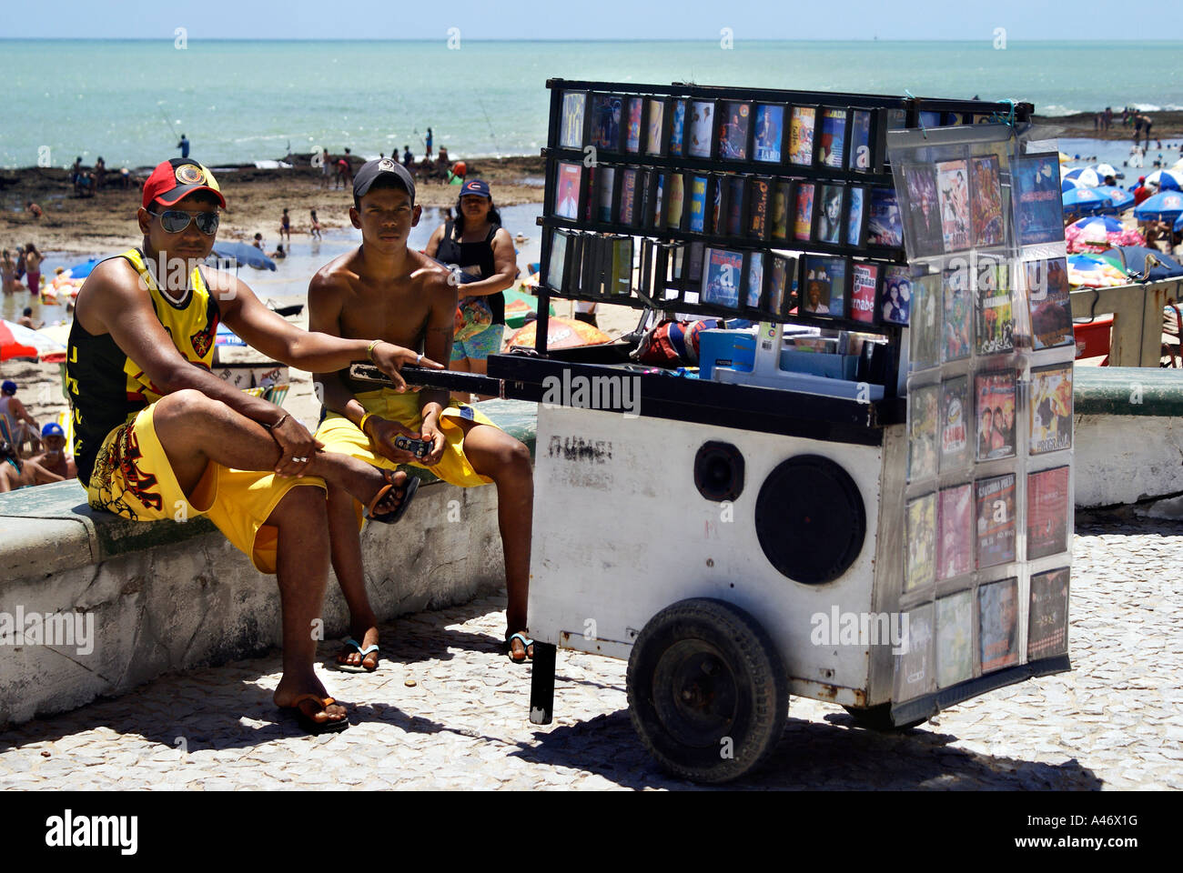 Dealers of illegally copied DVDs (pirate copies) at a beach in Recife, Brazil - Stock Image