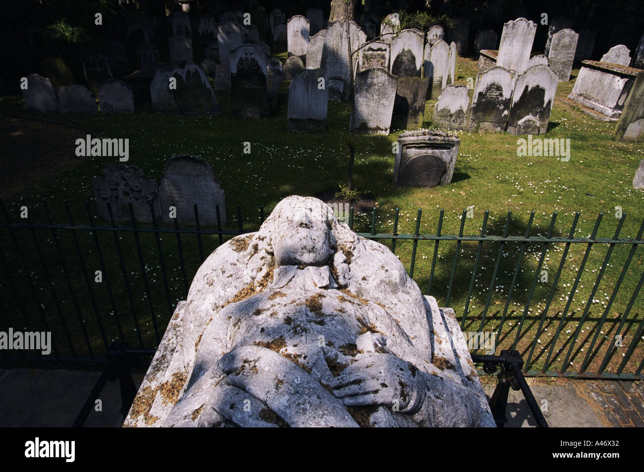 The grave of John Bunyan author of 'The Pilgrim's Progress' in Bunhill Fields London UK - Stock Image