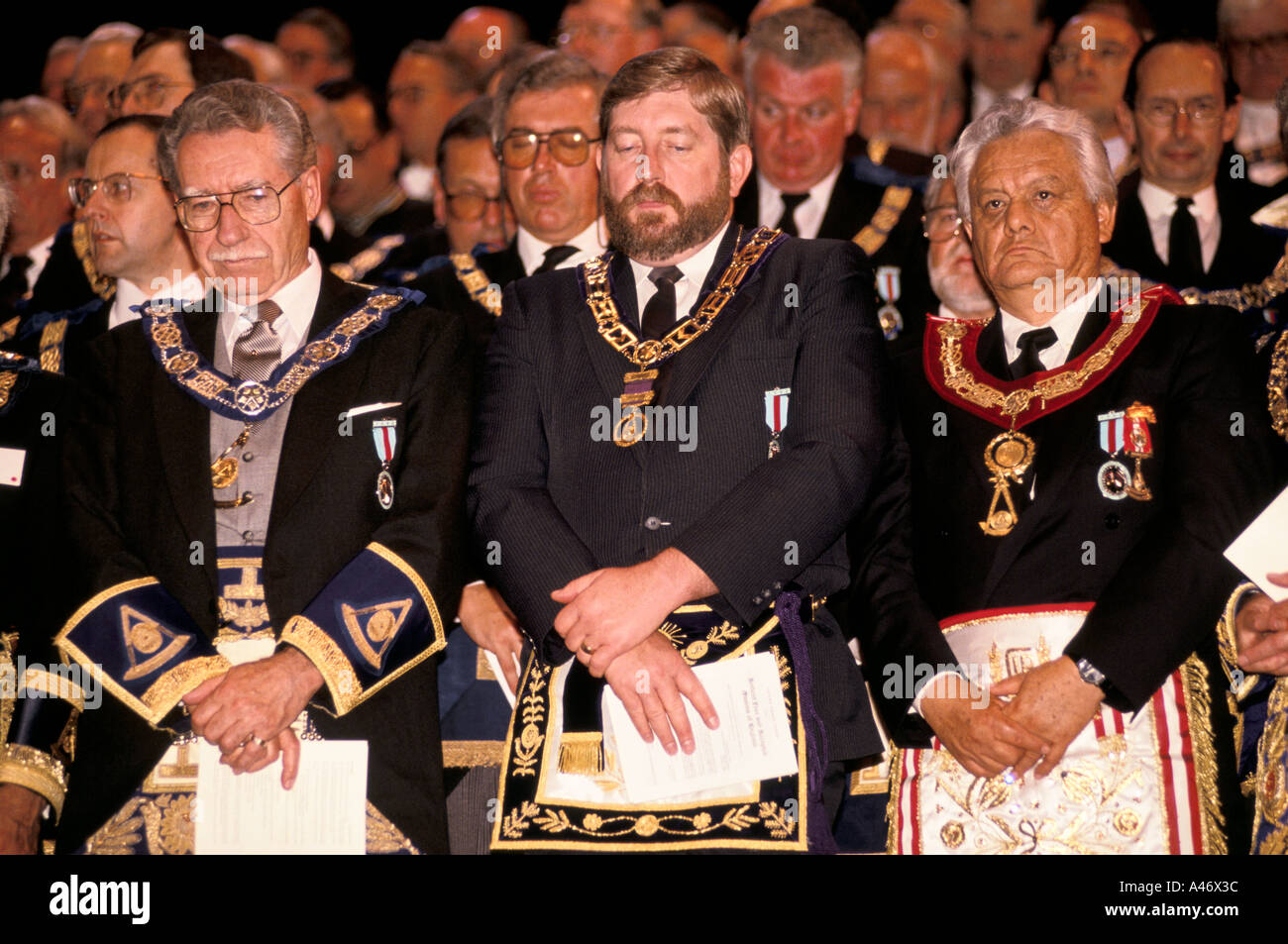 Freemasons at Earls Court Arena in London UK for a mass gathering - Stock Image