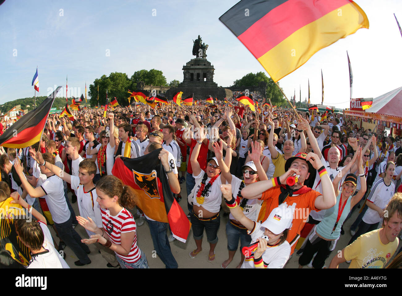 Thousands of spectators at the o public viewing of the opening of soccer world-cup 2006 at the German Corner, Koblenz - Stock Image