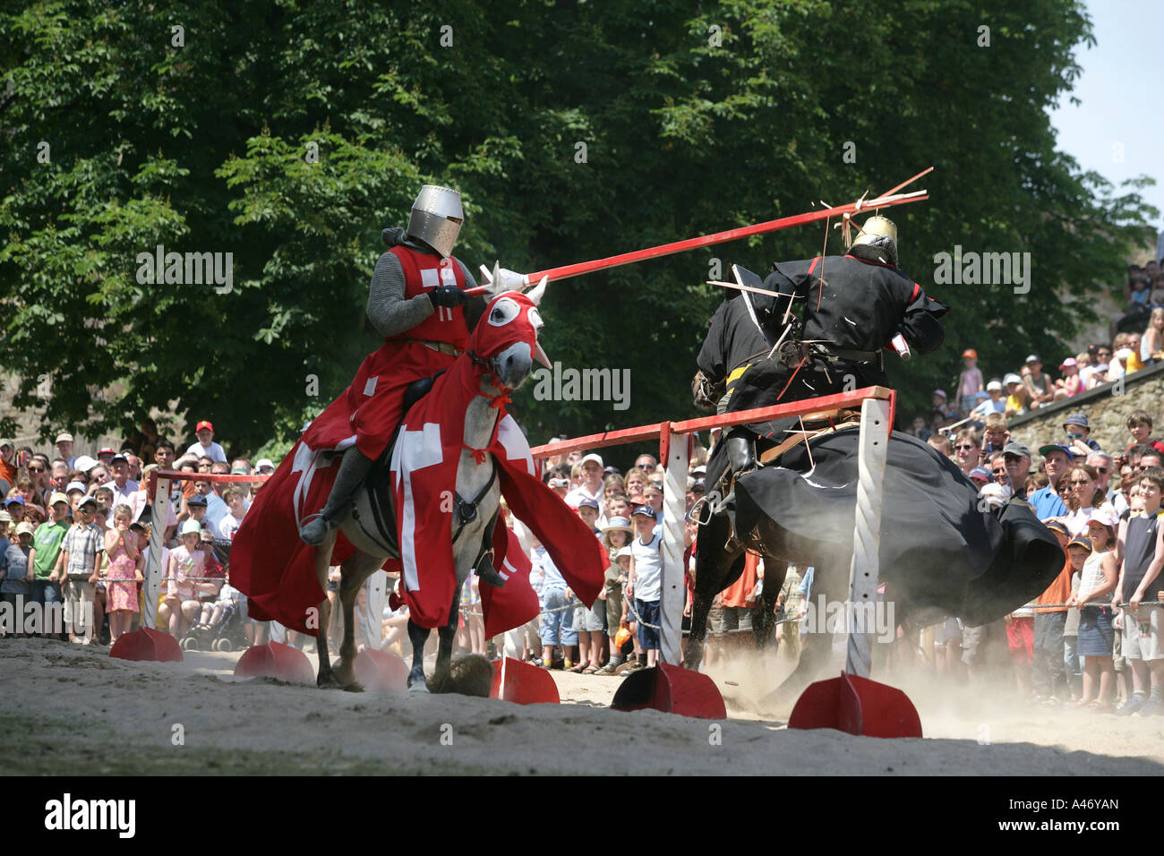 Two knights on horses are fighting with lances at a show on the fortress Ehrenbreitstein near Koblenz, Rhineland - Stock Image