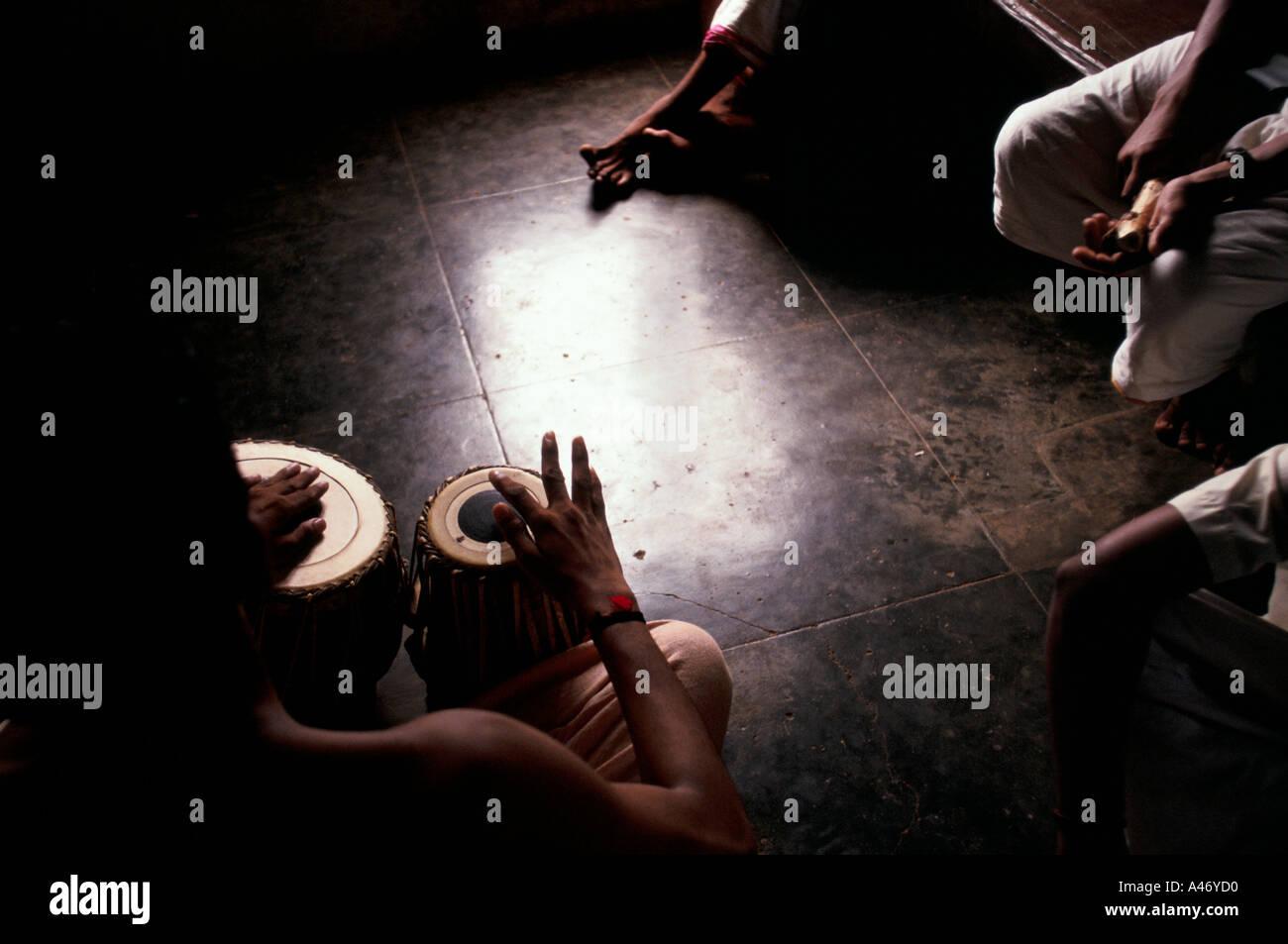 Kathakali students practice their drumming at The Kerala Kalamandalam, the state academy for Kathakali, Kerala, India - Stock Image