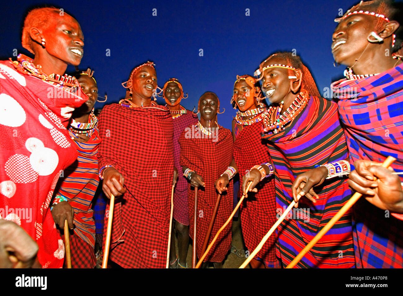 Maasai warriors stand in circle to sing Singing done to celebrate passages in life such as circumcision and marriage Kenya - Stock Image