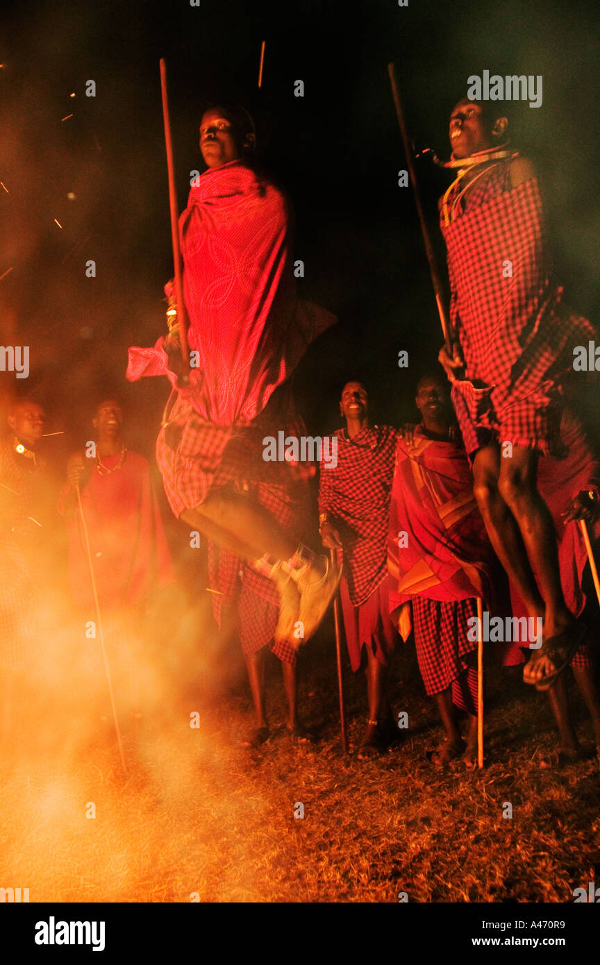 Maasai Warrior jumping dance Leap into the air to demonstrate strength and agility Model released Kenya - Stock Image