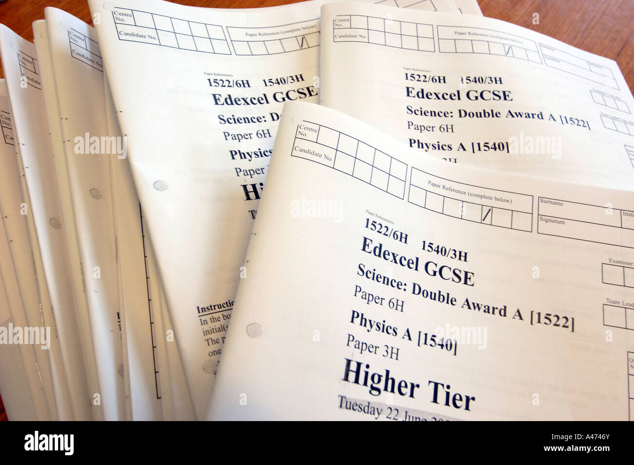 Test papers for a mock examination for GCSE in Science Physics - Stock Image