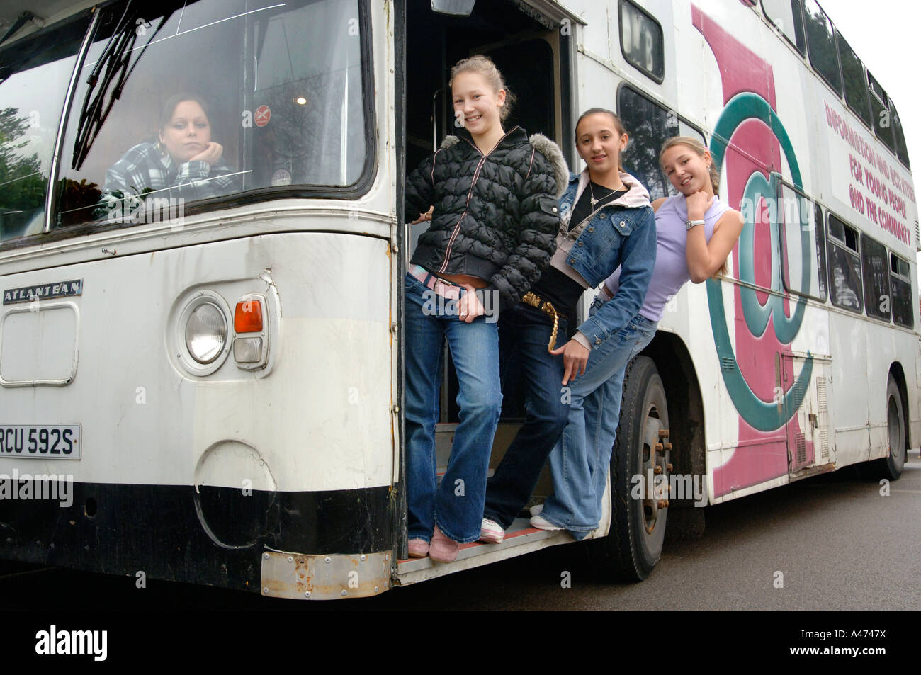 Four teenage traveller girls on a double decker community bus used as a classroom Stock Photo