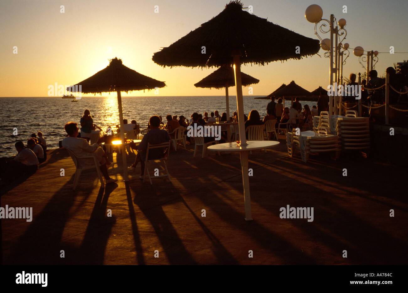 Sunset at Cafe del Mar Sant Antonio del Portmany Ibiza Balearic islands Spain - Stock Image