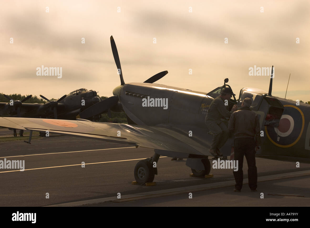 WWII Spitfire with Lancaster Bomber in background Biggin HIll UK - Stock Image