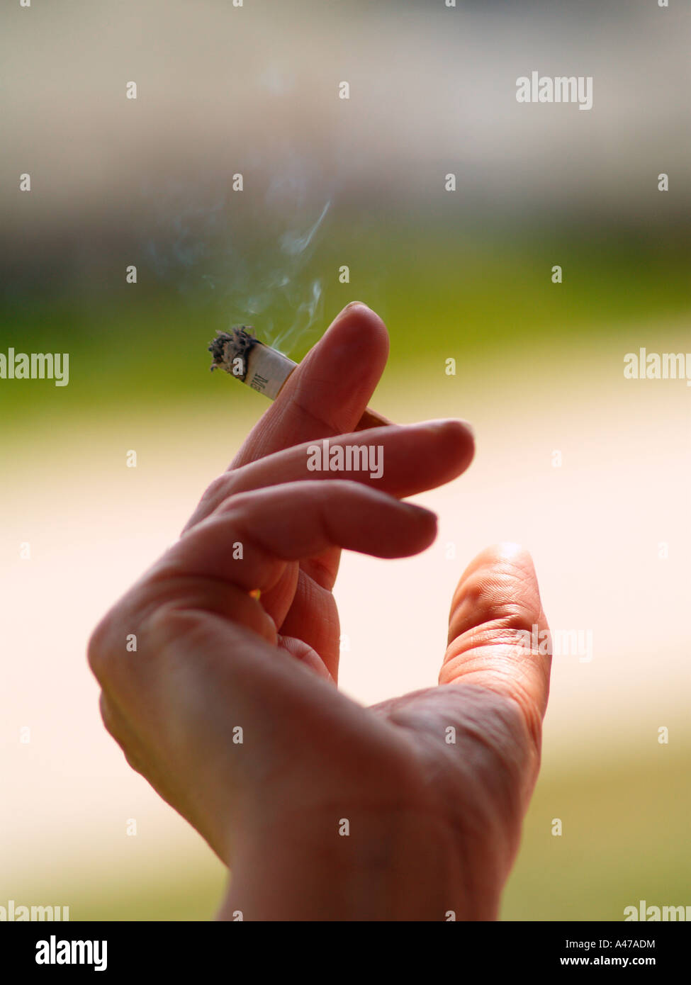hand in motion with cigarette - Stock Image