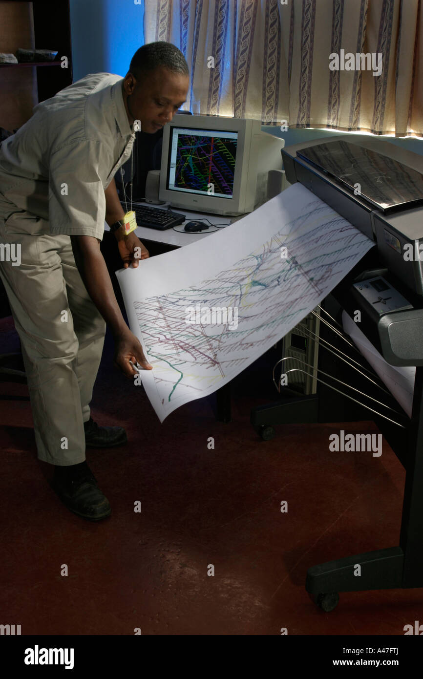 Geologist plotting three dimensional maps of underground gold mine, Ghana, West Africa - Stock Image