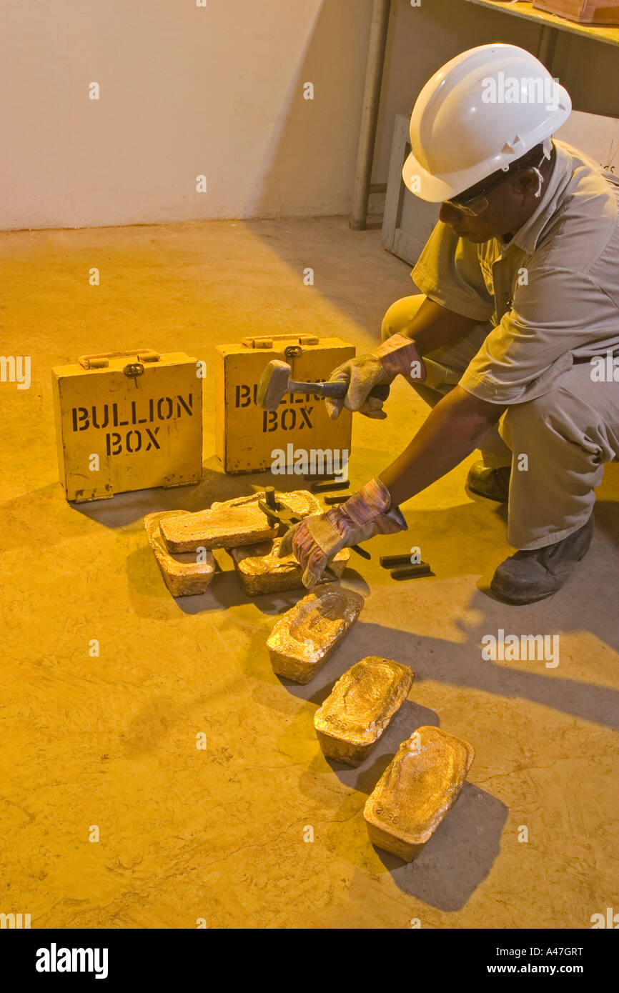 Stamping gold bars with serial numbers before boxing and shipping, gold mine, Ghana, West Africa - Stock Image