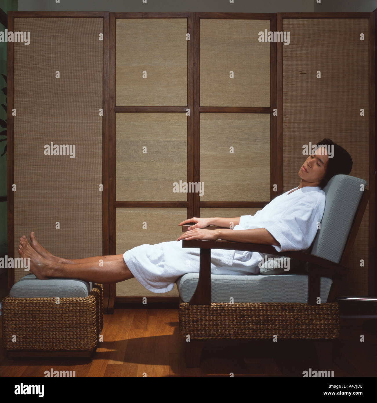 Asian man sleeping in spa - Stock Image