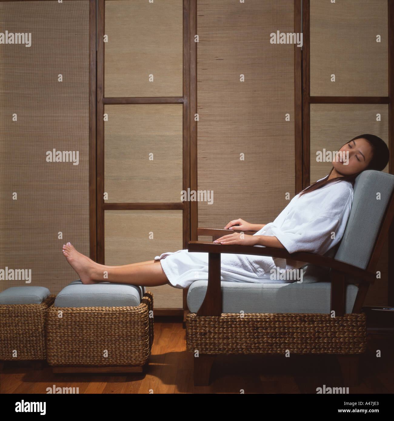 Asian woman sleeping in spa - Stock Image