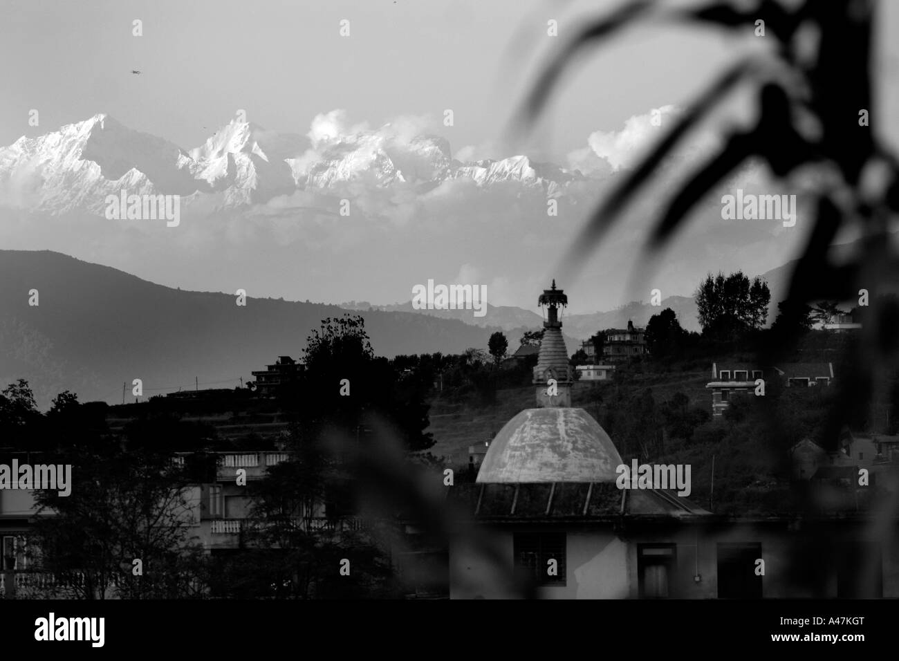 A view of the mighty Himalayan mountain range from the rural village of Bungamati outside of Kathmandu in Nepal - Stock Image