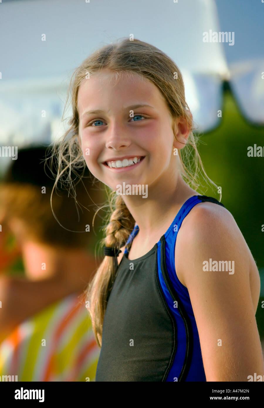 Portrait of girl at outdoor swim meet - Stock Image