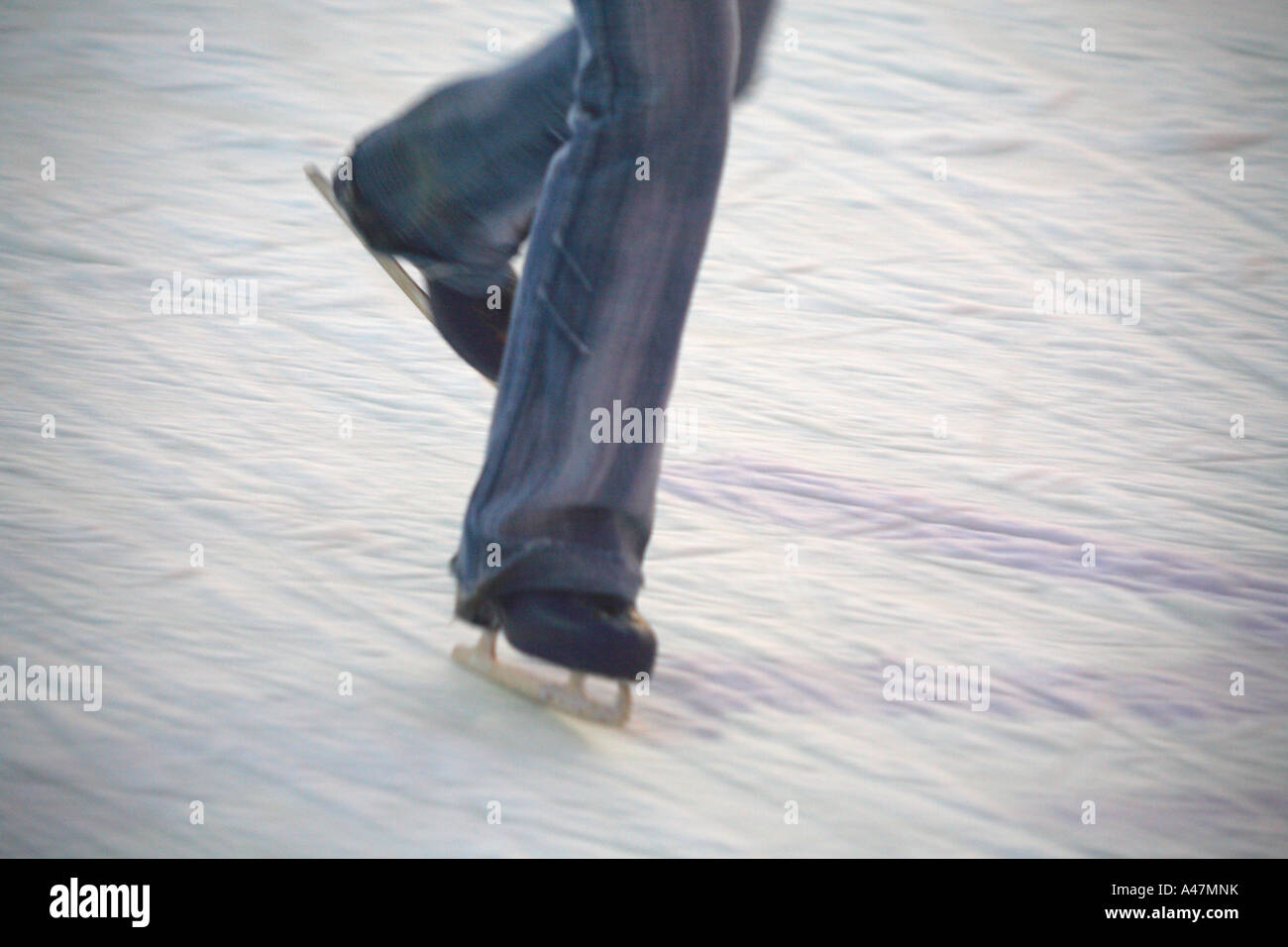 France Les Gets ski resort town village traditional ice skate skating cold leisure fun boots blade active danger - Stock Image