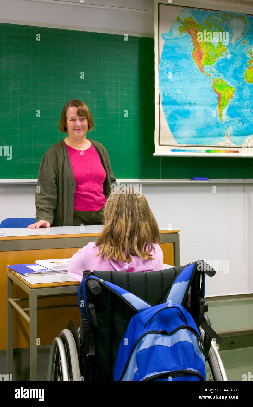 Disabled girl in classroom - Stock Image