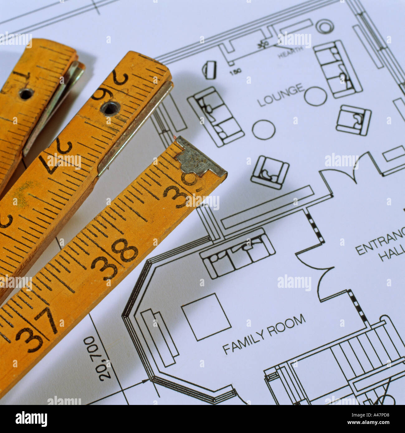 Extendable ruler and architectural blueprints - Stock Image