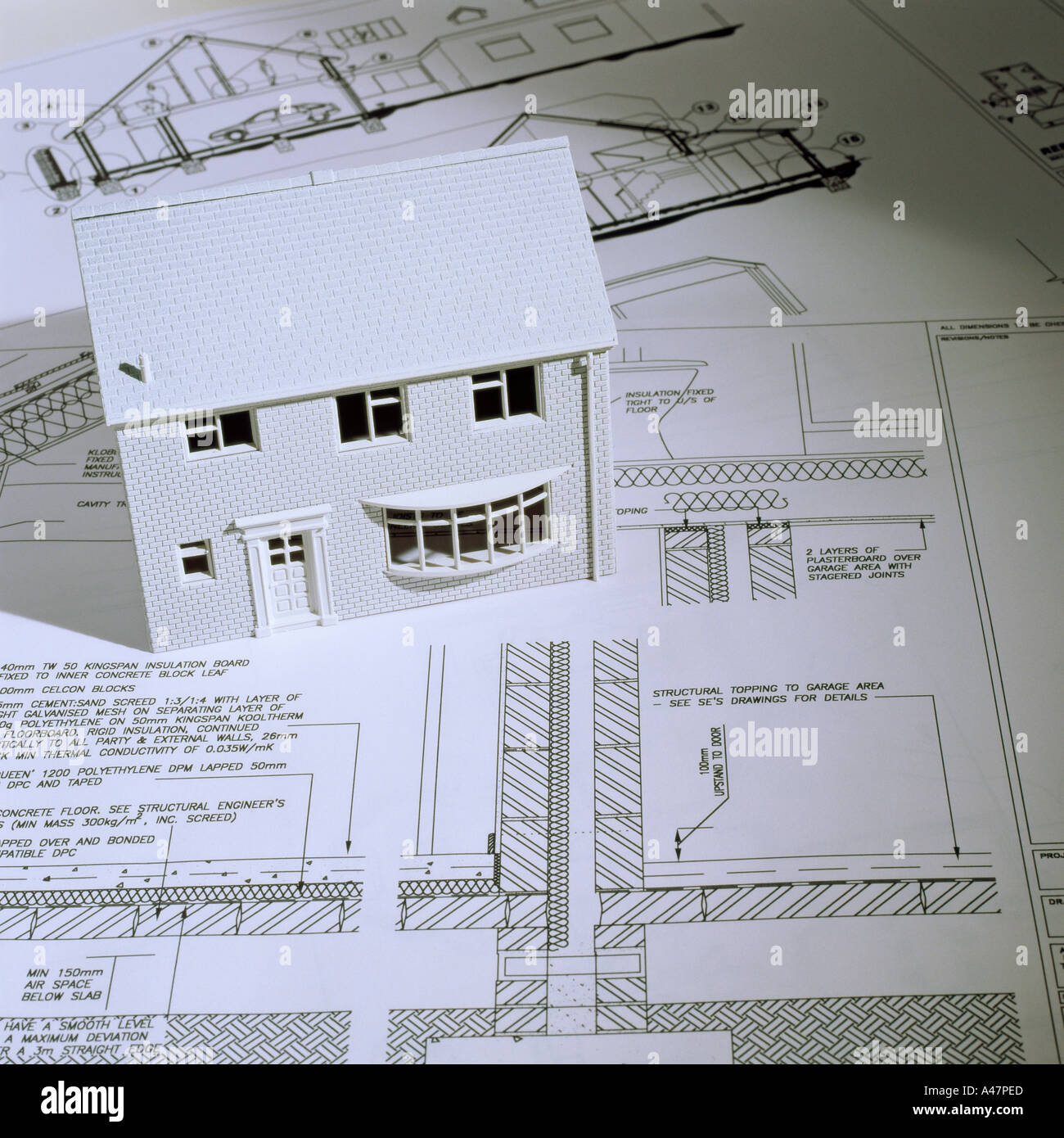 Model house and architectural blueprints - Stock Image
