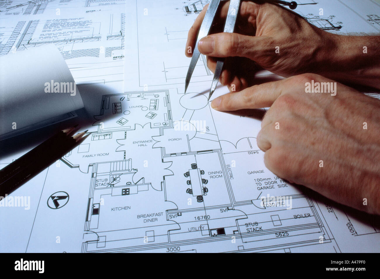 Dio shot stock photos dio shot stock images page 2 alamy architect working on blueprint stock image malvernweather Image collections