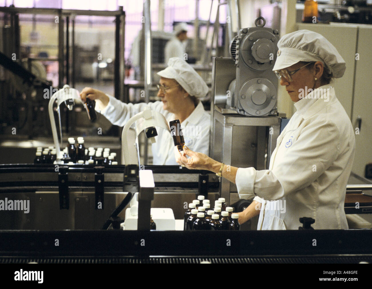 Checking bottles of eyewash . Boots pharmaceutical factory Nottingham - Stock Image