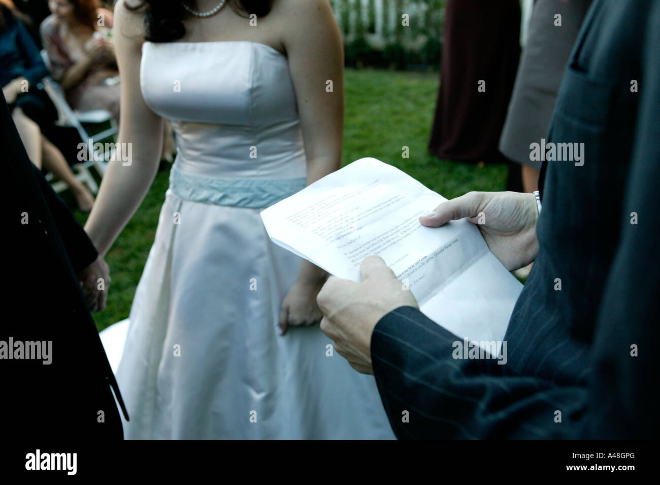 Bride and groom during marriage ceremony, mid section Stock Photo