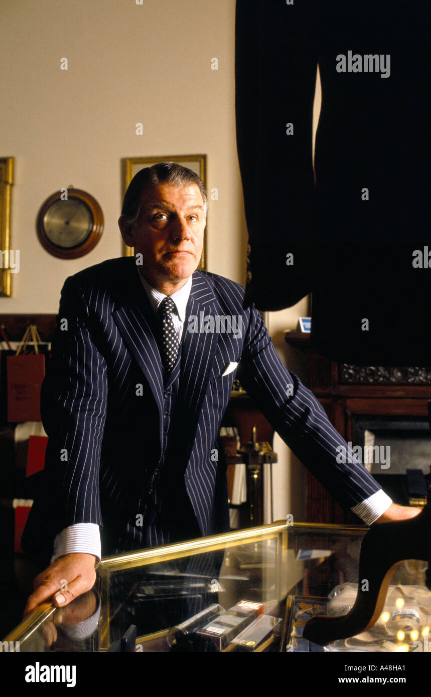 saville row tailor in shop - Stock Image