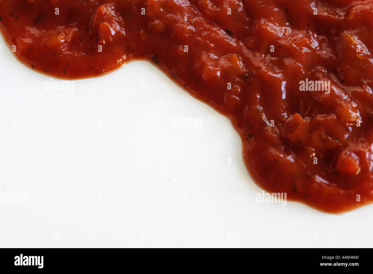 Packaged tomato passata on white background - Stock Image