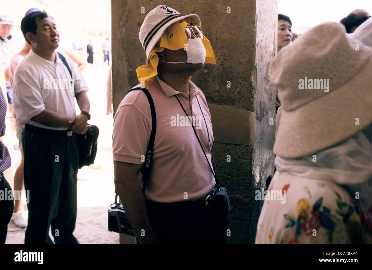 A japanese tourist wearing a face mask and vizor at the temple of hateshput in the valley of the kings Stock Photo